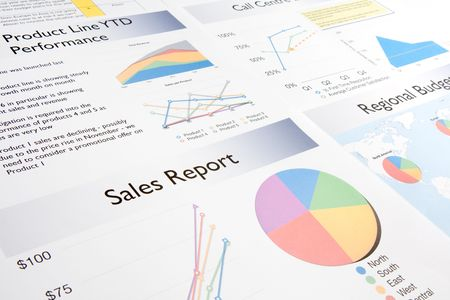 A business report containing a number of colourful charts and graphs. Stock Photo - 6831693