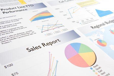 informe comercial: Un informe de negocio que contiene un n�mero de tablas colorido y gr�ficos.