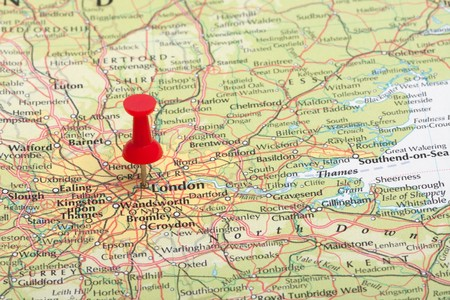 A red map pin pointing at London, England. photo
