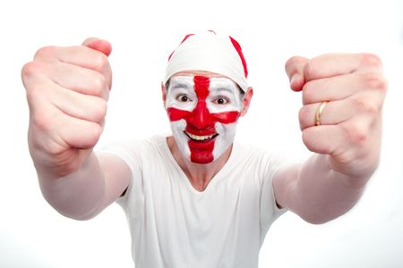 An English sports fan cheers and holds his fists out.  Differential focus on the face.  The fan has an England flag bandana and his face painted with the England flag.    Studio isolated on white. photo