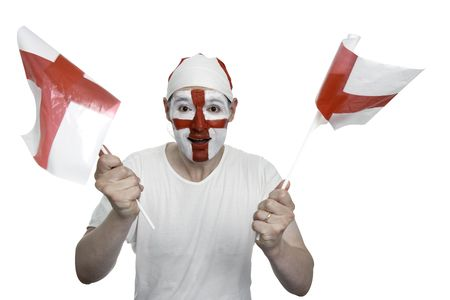 An English sports fan cheers and waves two England flags. The fan has an England flag bandana and his face painted with the England flag.    Studio isolated on white with an accurate clipping path. photo
