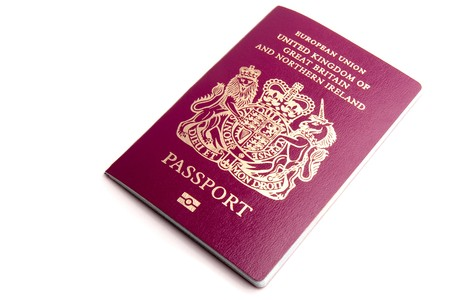 A UK biometric passport isolated on a white background. photo