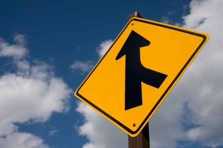 merge: A road sign offering direction.