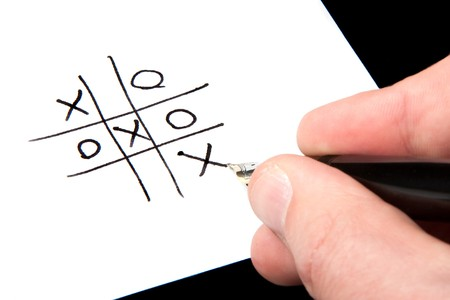 A male hand winning at tic-tac-toe. photo