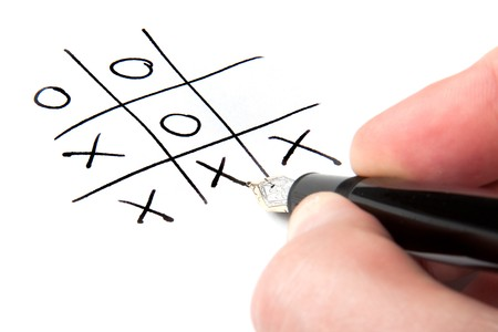 A male hand winning at tic-tac-toe. Stock Photo - 7111395