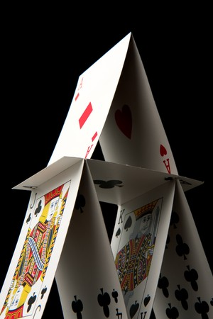 A house of cards on a black background.