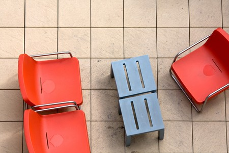 seating area: Some orange chairs in an outdoor seating area seen from above.
