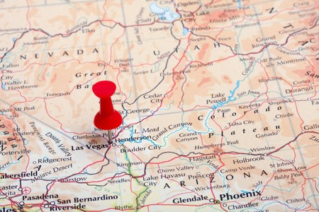 A red pushpin in a map pointing at Las Vegas, NV. photo