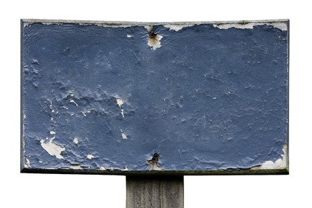 blanked: A blank sign with very old, blistered and worn blue paint.  Blanked out for your own words to be used.  Stock Photo