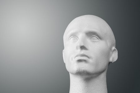 polystyrene: A studio lit white expanded polystyrene foam male head of generic design.  Stock Photo
