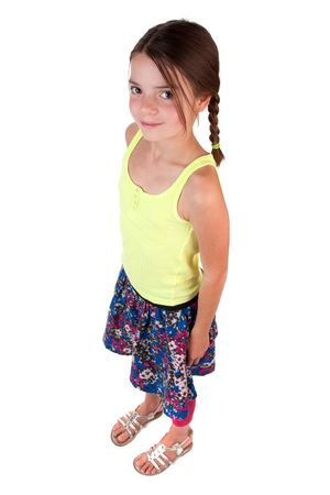 9 year old girl: A 9 (almost 10!) year old girl with long brown hair standing and looking up at the camera.