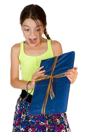 9 year old girl: A primary aged girl screams with excitement whilst holding a ribbon wrapped gift. Stock Photo