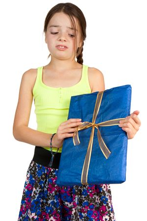 recieve: A primary aged girl looks disappointed to recieve a ribbon wrapped gift.