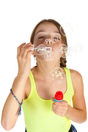 9 year old girl: A primary aged girl blows some bubbles towards the camera.