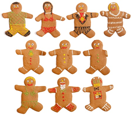 A collection of 10 home made gingerbread people.  Featuring: Boy in shorts, girl in bikini, groom, bride, happy man, worried man, sad man with one arm, blonde in bikini, old man, robot.  Studio isolated on a white background. photo