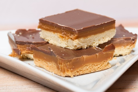 shortbread: A closeup of some homemade chocolate and caramel millionaires shortbread on a plate. Stock Photo