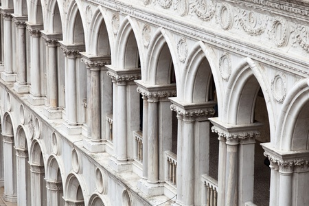 doges: A frame filling pattern of arches from the inner facade of the Doges Palace in Venice.