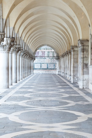 A row of arches underneath the Doges Palace in Piazza San Marco in Venice. photo