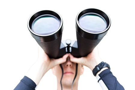 finding: A wide angle shot of a man holding large binoculars.  Differential focus on the front of the binoculars.  Isolated on white.