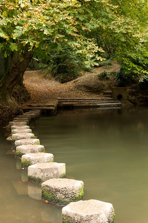 allow: Some stepping stones allow a shallow river to be crossed.