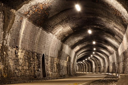 disused: A curved tunnel in the Peak District in Derbyshire.  Originally a Victorian railway tunnel it is now part of a public footpath. Editorial