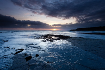 A coastal sunset from Kimmeridge in Dorset, UK. photo