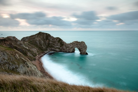 durdle: Looking down on Durdle Door in the Jurassic Coast in Dorset, UK.  Taken 30 minutes before sunrise so the clouds have a pre-dawn glow.