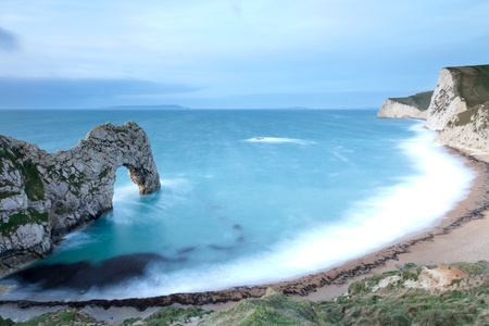 durdle: A view of Durdle Door bay with the morning sun just starting to light up the inside of the arch.