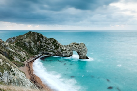 durdle door: Looking down on Durdle Door in the Jurassic Coast in Dorset, UK.  Taken at sunrise (the sun is on the horizon about 10% in from the left!)