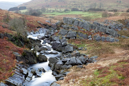 elan: The River Claerwen in the Elan Valley, Wales flows between some rocks.