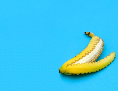 banana slice: A banana that has been opened in an unusual way   Shallow depth of field with focus on the inside of the banana
