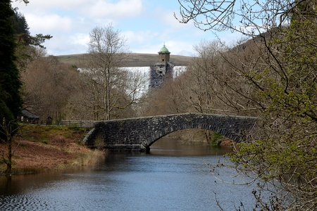 elan: A bridge over the reservoir at the bottom of the Penygarreg Dam in Elan Valley, Wales