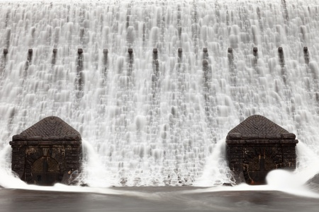 elan: A close up of the water streaming over the Caban Coch dam in the Elan Valley, Wales.