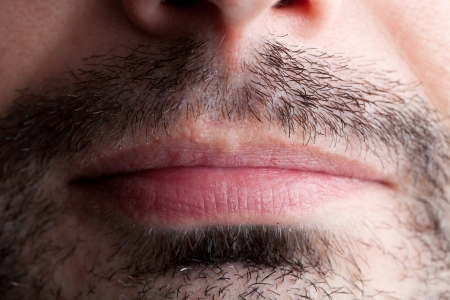 stubble: A macro closeup of a very stubbly mouth region of a male face.