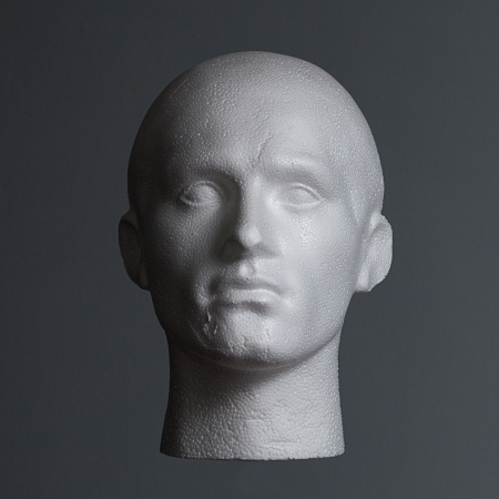 male mannequin: A polystyrene head on a grey background side lit