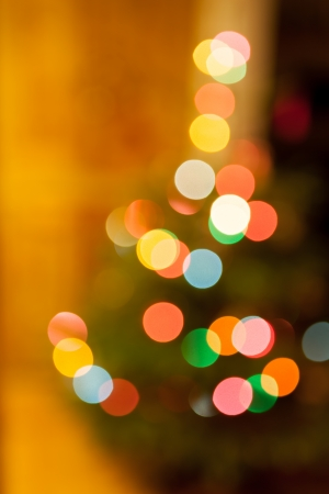 causing: An abstract shot of multi-coloured Christmas tree lights causing a bokeh effect. Stock Photo
