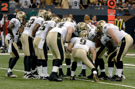 Drew Brees and the New Orleans Saints offense in the huddle during a game at the Louisiana Superdome Sept 13, 2009