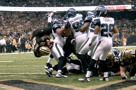 touchdown: Chris Ivory of the New Orleans Saints dives over the Seattle Seahawks defensive line to score a touchdown at the Louisiana Superdome Nov 21, 2010
