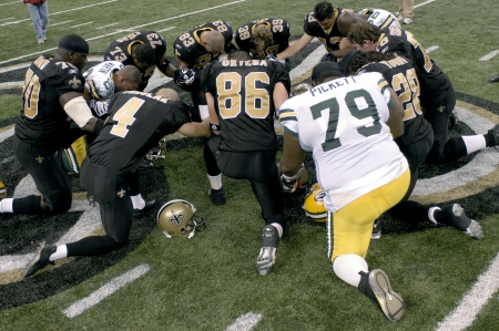Post game prayer by members of the New Orleans Saints and Green Bay packers at the Louisiana Superdome Nov 24, 2008