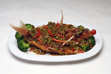 Oriental, Asian food served on a dish in a restaurant setting  Plenty of white space for text  Banco de Imagens