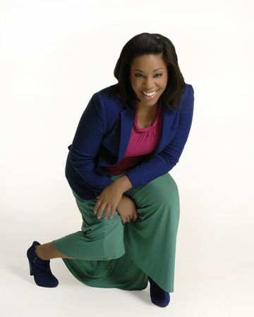 Attractive african american female in casual business attire with a happy,  successful look and demeanor  Isolated on a white background  Banco de Imagens