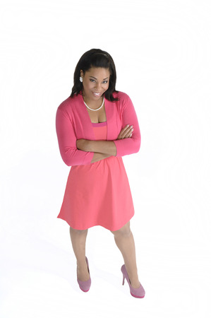 Attractive african american female in casual business attire with arms folded shot from a high angle