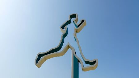 Isolated running man on blue sky background represent sport activity and healthy lifestyle