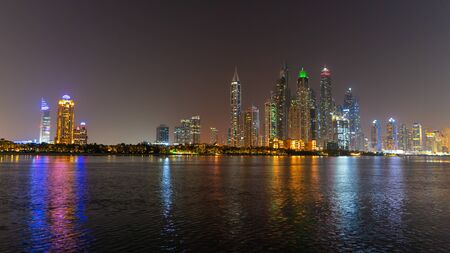 Dubai skyline at night with lights on the water and luxirious skyscrapers of UAE. Modern architecture of the future. Reklamní fotografie