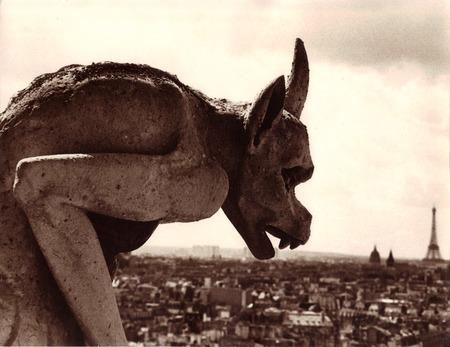 Gargoyle overlooking Paris Stock Photo