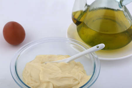 mayonnaise sauce with olive oil on the side