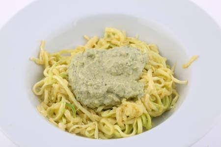 zucchini spaguetti with green pesto as delicious vegan healthy