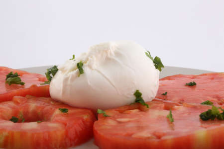 tomato and mozarella salad with basil leaf
