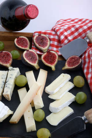 Cheese board variety with grapes and figs