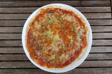 italian pizza with ham tomato and mozarella
